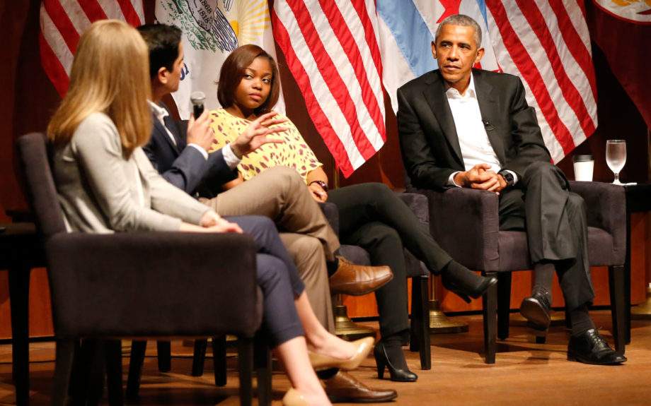 Former President Barack Obama listens to a group of students at the University of Chicago. AP / Charles Rex Arbogast