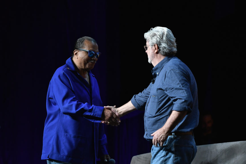 Billy Dee Williams and George Lucas shake hands at Star Wars Celebration Day 1 on April 13 in Orlando, Florida.  Photo: Gustavo Caballero/Getty Images