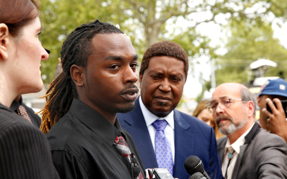 Nandi Cain, left, discusses the alleged beating he received from a Sacramento Police officer two weeks ago during a news conference. AP / Rich Pedroncelli