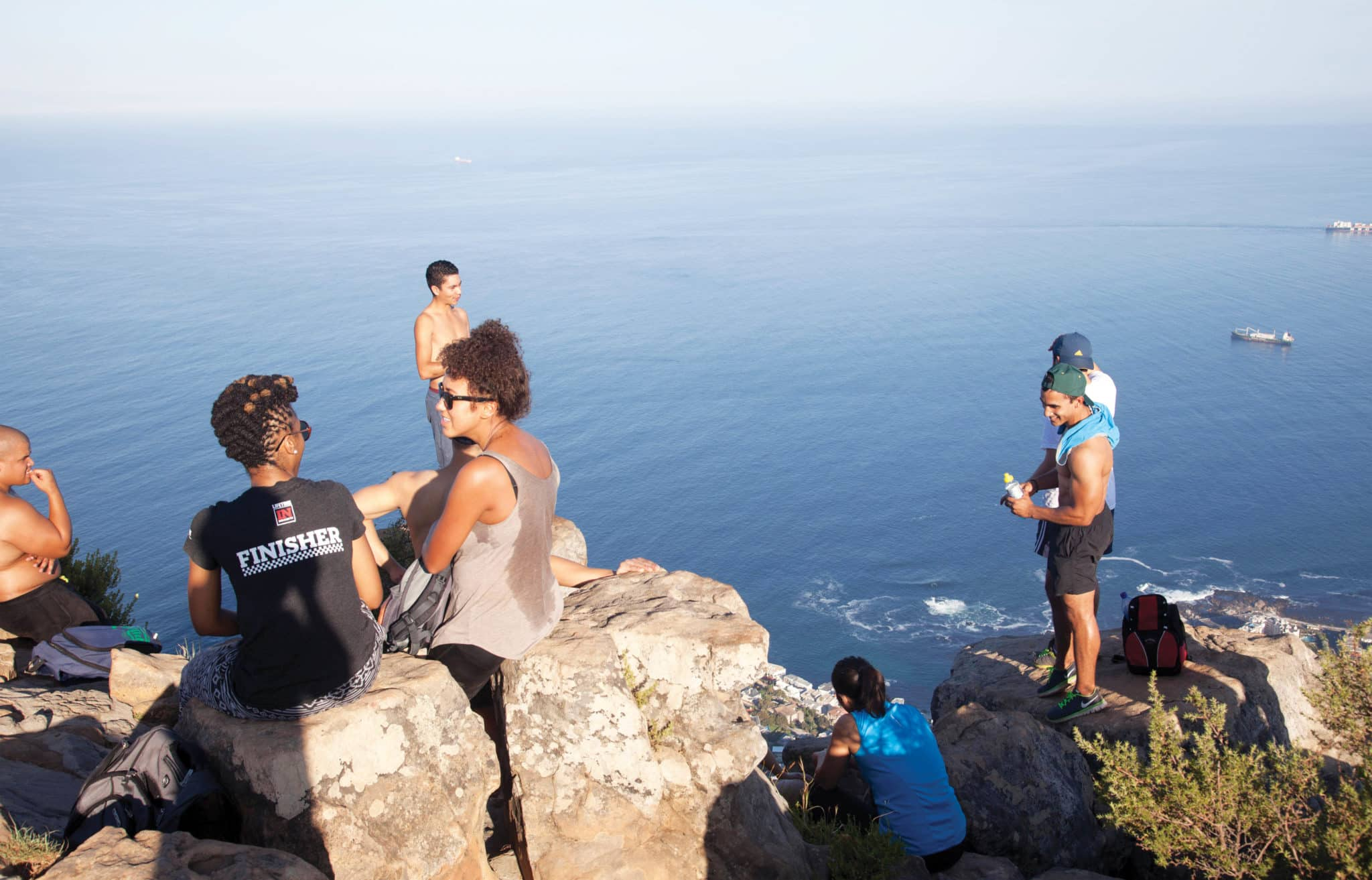 FTXK58 Hikers at the Top of Lions Head Early morning in Cape Town - South Africa