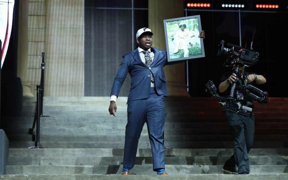 Takkarist McKinley carries a picture of his grandmother, Myrtle Collins, when he is picked by the Atlanta Falcons at the 2017 NFL Draft. Allen Kee / ESPN Images