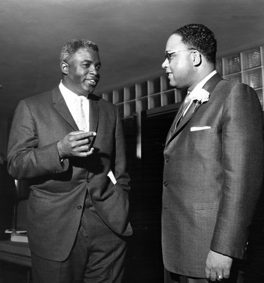Jackie Robinson is pictured chatting with Rep. Charles C. Diggs Jr. (Moneta Sleet, Jr. / EBONY Collection)
