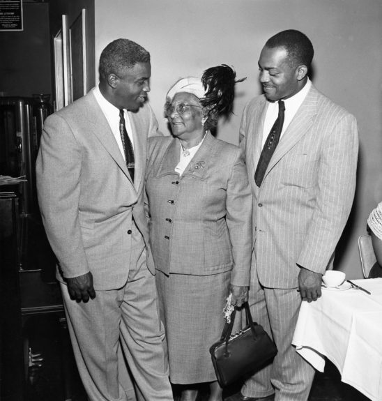 Jackie Robinson is pictured with mother Mrs. Mabel Robinson and Kenny Washington. (Howard Simmons/ EBONY Collection)