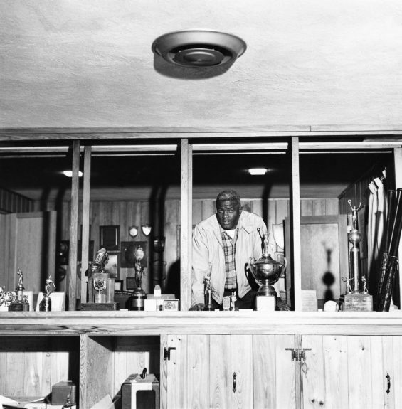 Jackie Robinson is pictured with awards and other trophys. (G. Marshall Wilson/ EBONY Collection)