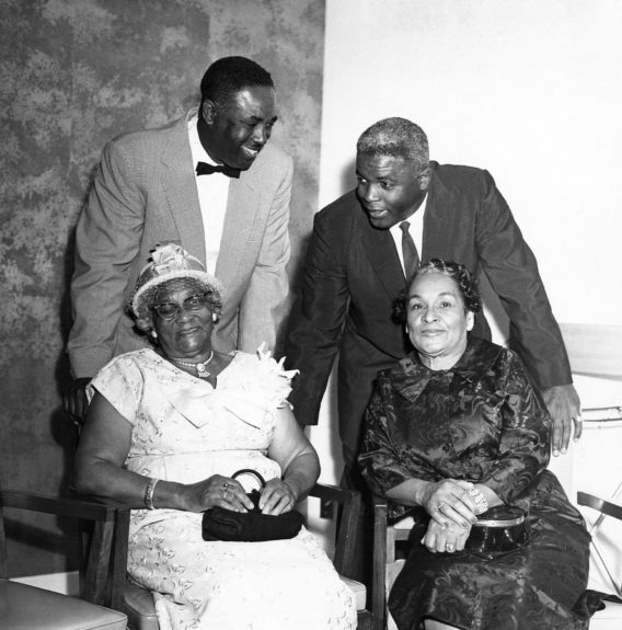 Jackie Robinson and brother Mack Robinson are pictured with their mother and Jackie's mother-in-law. (William Lanier / EBONY Collection)