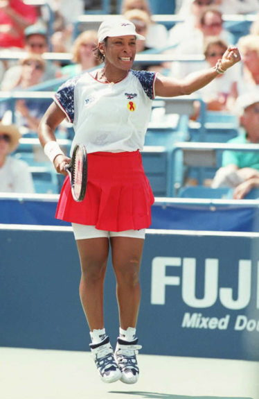Zina Garrison-Jackson of the US celebrates match point in her match against Lindsay Davenport of the US on August 31, 1995 at the US Open. Garrison-Jackson upset the tenth-seeded Davenport 6-1, 6-3.