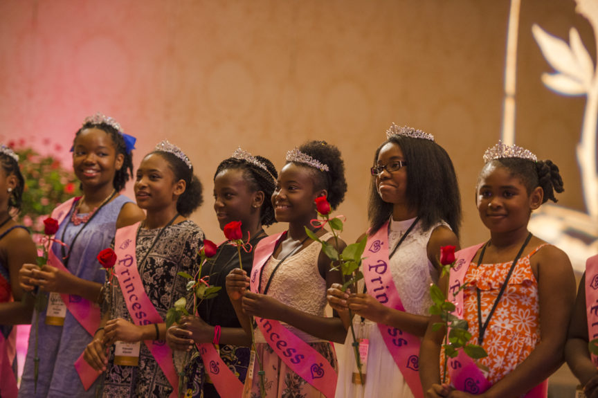 Princesses prepare to present their moms with a sweet thank you rose