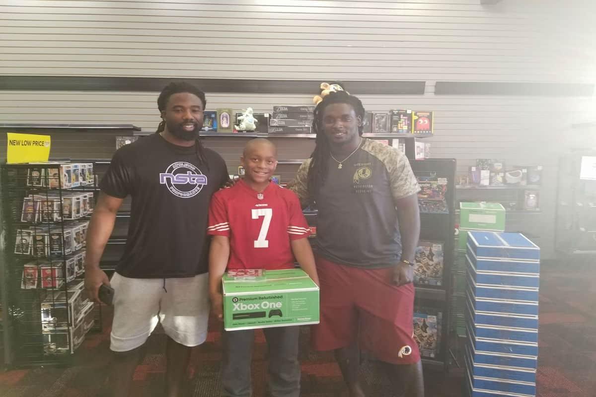 10-year-old Jaden Watts with Washington Redskins players Keith Marshall and Rob Kelley