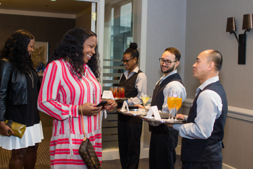 Guests enjoying their cocktails choices, courtesy of Belvedere and Hennessy!