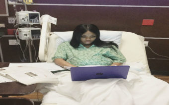 A Kansas college student completes her college final while in labor.