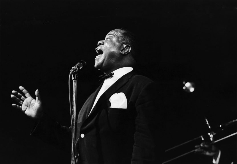 Louis Armstrong performing.