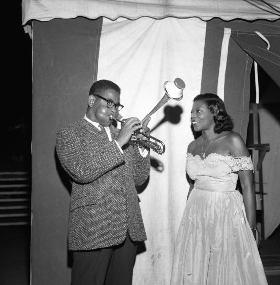 Mary Lou Williams listens to Dizzy Gillespie on the horn, 1957.