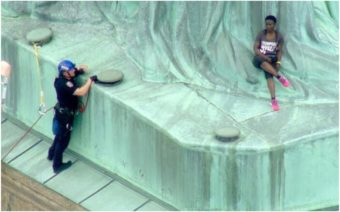 Black woman, statue of liberty
