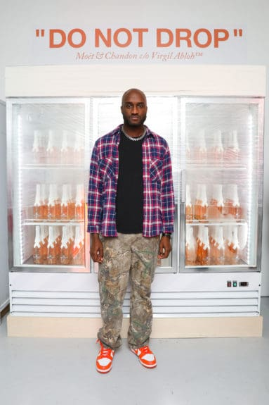 "Virgil Abloh in front of ""Do Not Drop"" display at the launch of Moët & Chandon Nectar Impérial Rosé c/o Virgil Abloh™ in New York City (Photo Credit: BFA)"